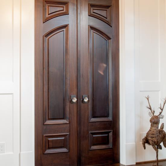 Pair of custom hallway doors in walnut with big bolection moulding (BBM) and scoop (B) panel.
