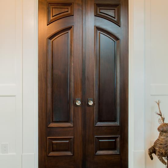 Custom hallway doors in walnut with big bolection moulding (BBM) and scoop (B) panel