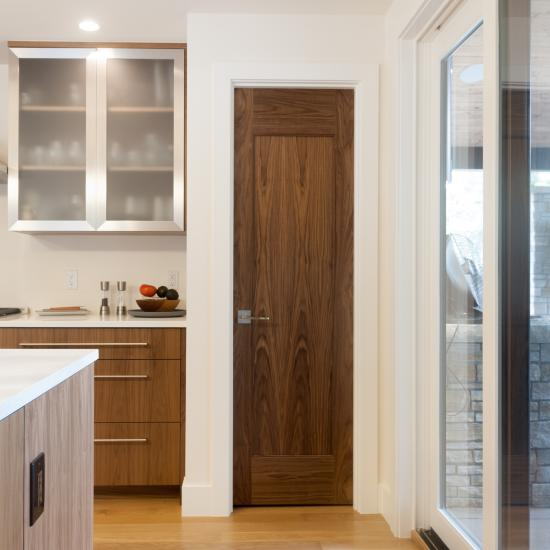 TM1000 pantry door in walnut with one step (OS) sticking and flat (C) panel
