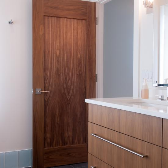 TM1000 bathroom door in walnut with one step (OS) sticking and flat (C) panel