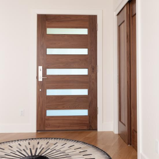 Interior view of TM5100 exterior door in walnut with white lami glass and one step (OS) sticking