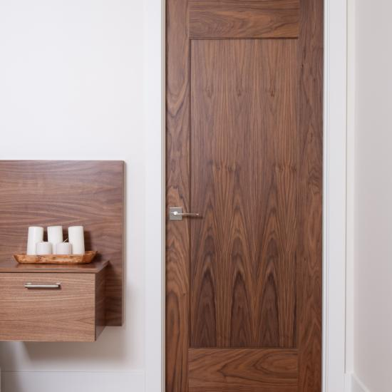 TM1000 bedroom door in walnut with one step (OS) sticking and flat (C) panel