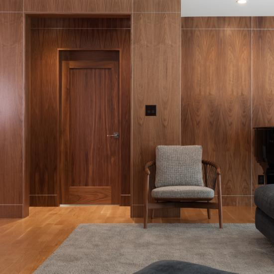 TM1000 door in walnut with one step (OS) sticking and flat (C) panel