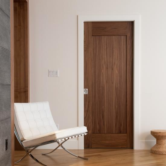 TM1000 pocket door in walnut with one step (OS) sticking and flat (C) panel