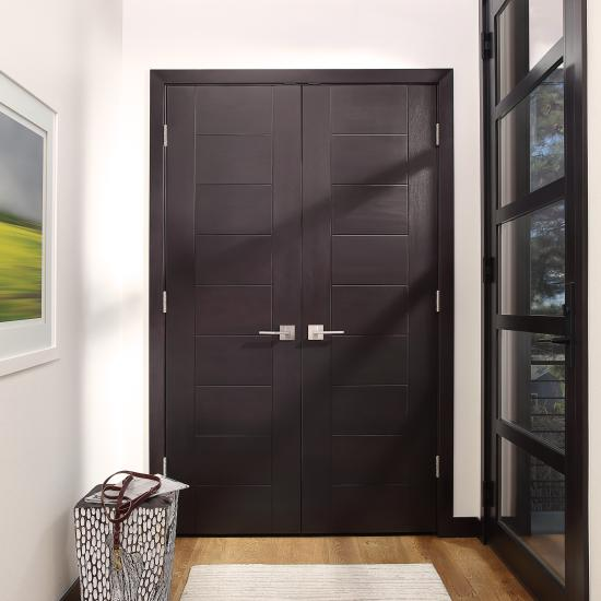 "TM9000 doors in select alder with Espresso hand-wiped stain and ¼"" kerf cut reveal."