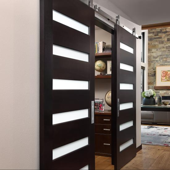 A pair of TM6100 barn doors in select alder with Espresso hand-wiped stain and White Lami glass.