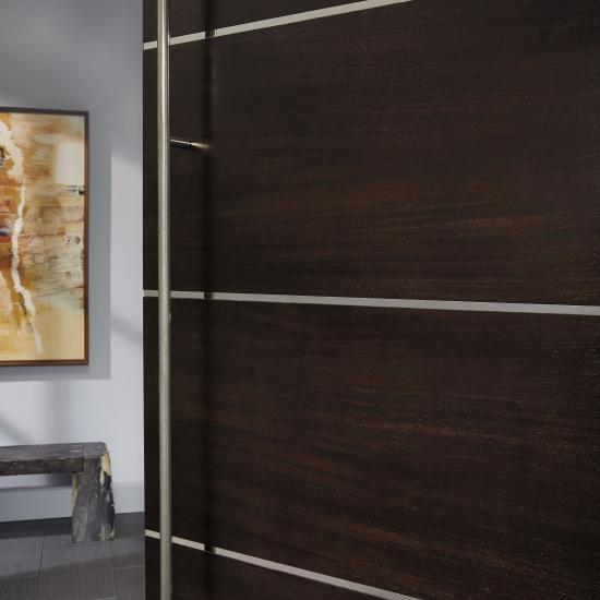 "Detail of TMIR6080 door in mahogany with Espresso stain and 1/2"" bright stainless steel inlay"