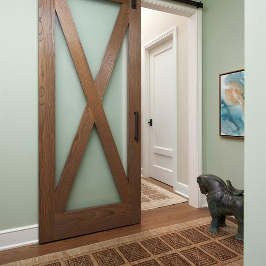 TS4240 barn door in wire-brushed white oak with Flow glass substituted for panels. MDF TS2210 door in background.