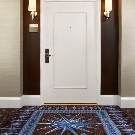The simple form, wide proportions and deep carved moulding of this TS1000 hotel room entry makes a dramatic impression.