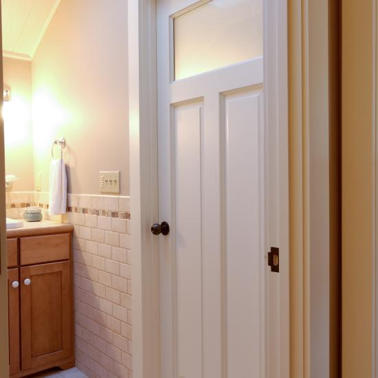 TS3240 bathroom door in MDF with Roman ogee (OG) sticking and raised (A) panel, top panel subsitituted with frosted glass.