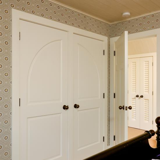 TS2070 closet doors in MDF with Roman ogee (OG) sticking and raised (A) panel.