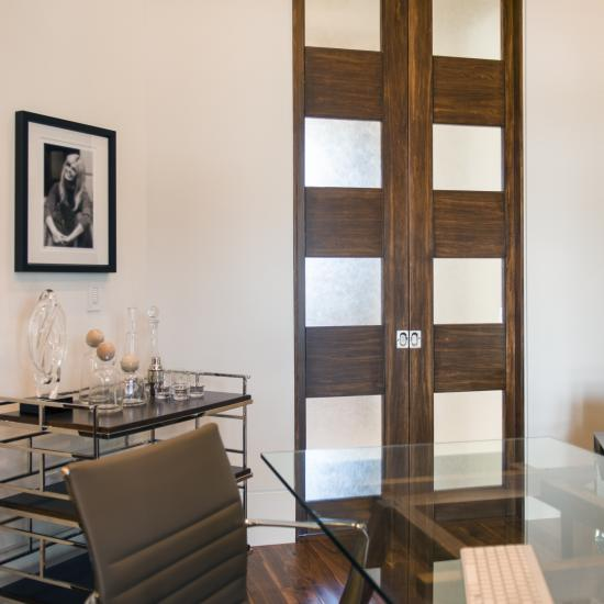 Pair of TM9160 pocket doors in walnut and Brushed glass with asymmetric stiles and kerf cut reveal