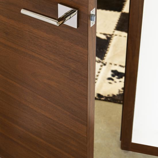 Detail TMF1000 flush door in walnut with Nutmeg stain
