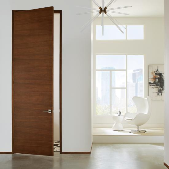 TMF1000 flush door in walnut with Nutmeg stain