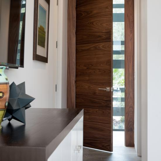"TMIR6000 in Walnut with 1/4"" kerf cut reveal and concealed hinges has clean lines for an ultra modern look"