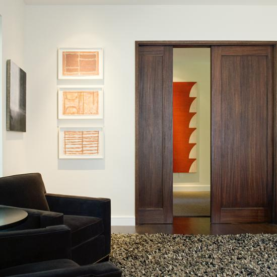 Pair of TS1000 pocket doors in walnut with square stick (SS) sticking and flat (C) panel