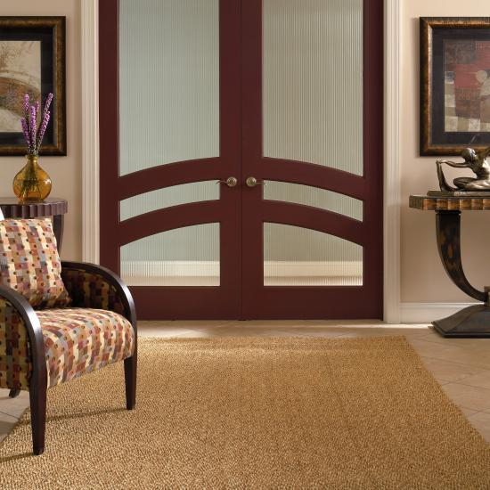 A TS3160 common arch pair in MDF with reeded glass provides a dramatic backdrop to this contemporary living room.