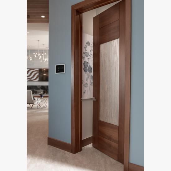 A TM9250 pantry door in walnut with Nutmeg stain and Thatch resin.