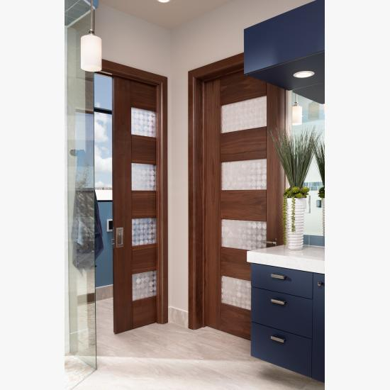 A contemporary master bath features TM9160 doors in walnut with Nutmeg stain and Capiz resin.