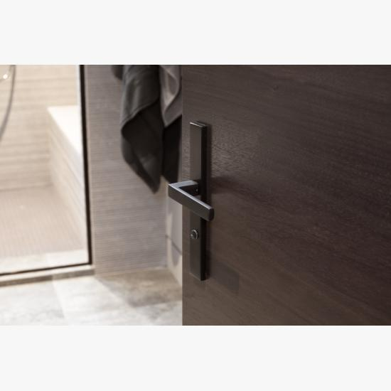 Detail of a TMF1000 flush door in walnut with Ebony stain.