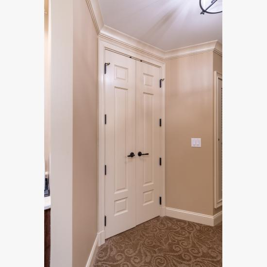 A pair of TS3100 doors in MDF with Roman Ogee sticking and Scoop (B) panel lead to the bathroom suite.