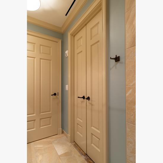 Pair of TS3070 doors in MDF with Roman Ogee (OG) sticking and Scoop (B) panel. Coordinating TS6050 to left.