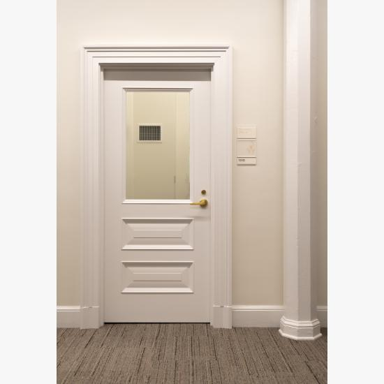 Custom panel lite door with clear glass, bolection (BM) moulding and raided (E) panel.