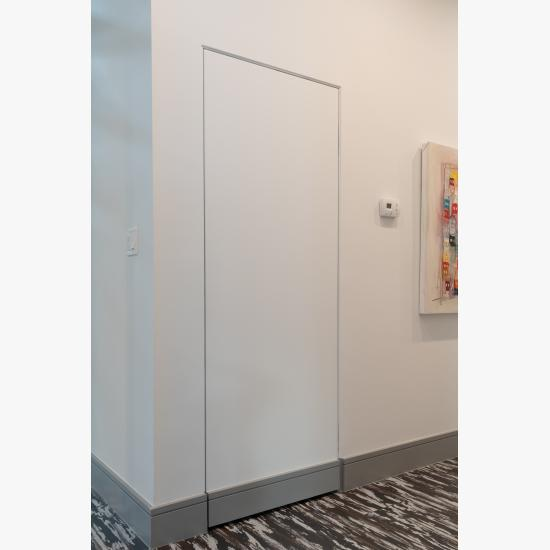 Concealed hinges and jamb allow this TMF1000 closet door in MDF to blend into the wall.