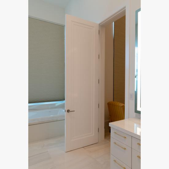 This master bath features monumental 10' tall TS1000 doors in MDF with Miracle (MR) moulding and Flat (C) panel.