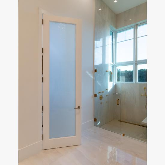 This master bath features 10' tall TS1000 door in MDF with One Step sticking and White Lami glass