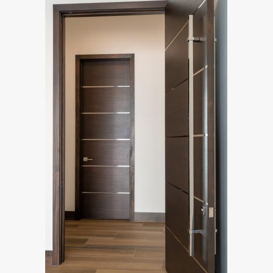 "TMIR6000 doors in mahogany with ½"" bright stainless steel inlays. Customer stained finish."