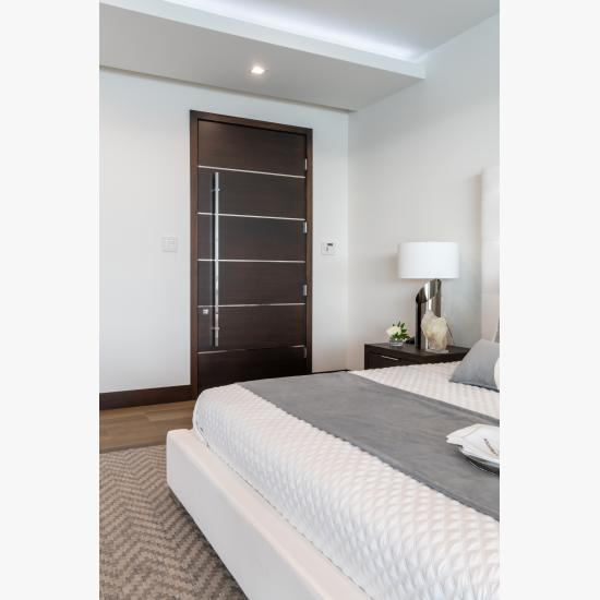 "TMIR6000 door in mahogany with ½"" bright stainless steel inlay. Customer stained finish."