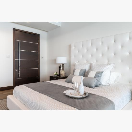 """TMIR6000 door in mahogany with ½"""" bright stainless steel inlay. Customer stained finish."""