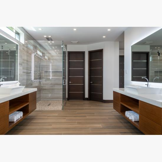 "This master bath features TMIR6000 doors in mahogany with ½"" bright stainless steel inlay. Builder provided stain finish."