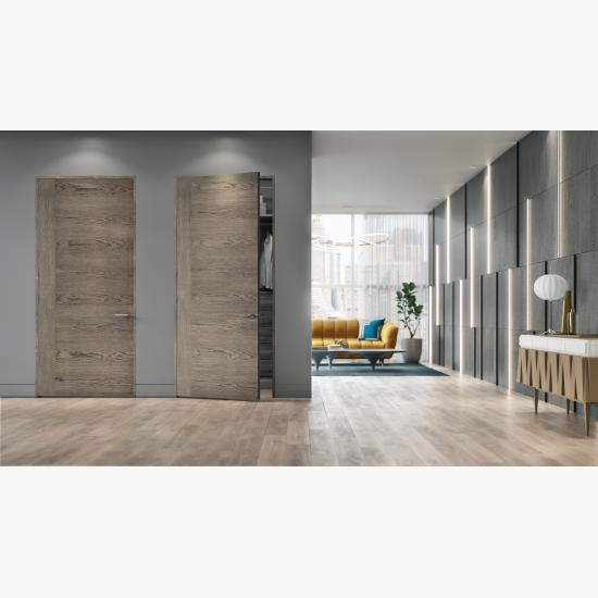 A living room features TMF1001 sketch face flush wood doors in White Oak with Grey Mist stain.