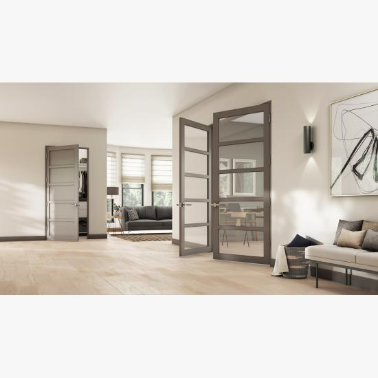 This living room features a pair of ultra narrow TMUN5000 doors in MDF with Square Stick (SS) sticking and clear glass. The door in back has a solid flat panels.
