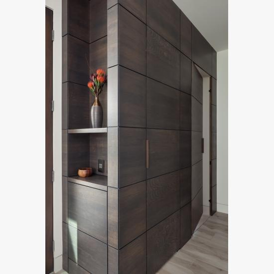 "This cabinet features carefully concealed TMIR5000 doors in rift sawn white oak with Espresso stain and ¼"" kerf cut reveal"